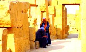 Guys chatting among the ruins of Karnak, Luxor, Egypt